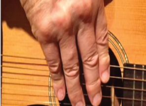 Older adult hand strumming guitar music therapy
