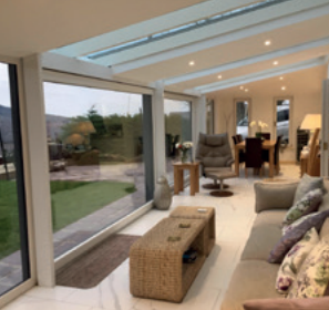 Skylights installed into a warm roof tiled conservatory for HOMESEAL in Chesterfield, Derbyshire.