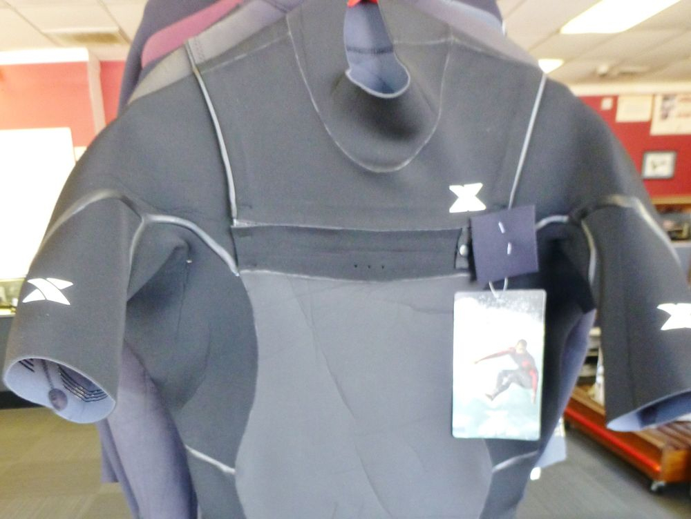 Black and gray men's exterra 3/4 wetsuit hanging on a rack