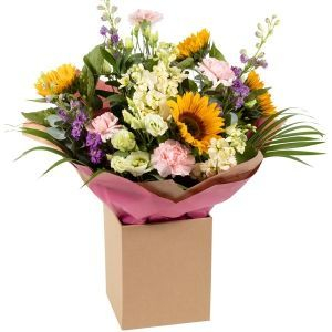 A truly wonderful selection of  flowers in a basket