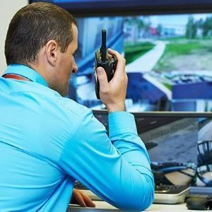 man at security monitoring job watching live video