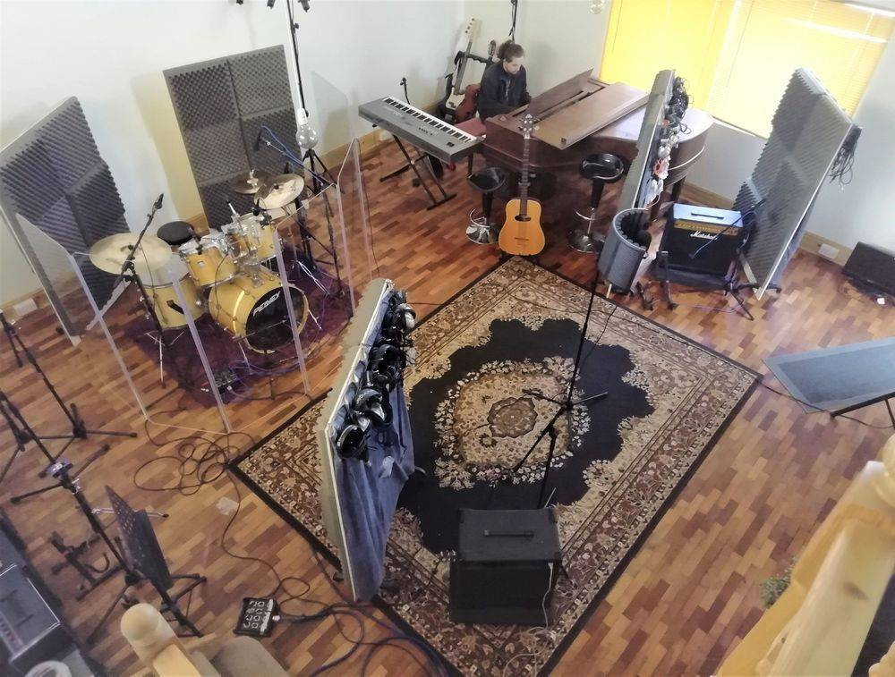 Music Studio Live Room with drums, piano and other music equipment