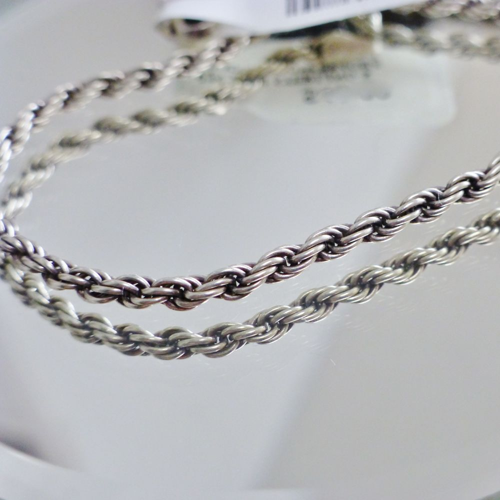 close up picture of a sterling silver rope braclet