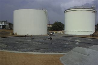 HDPE liner for Storage Tank containment; Completed secondary storage tank containment liner.