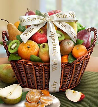 Send condolences their way basket filled with sensation and imperial pears,  fuji and granny smith apples, navel oranges, Kiwi and more