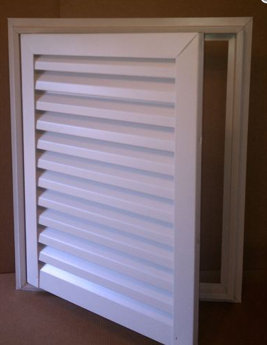 Hinged gable vent door