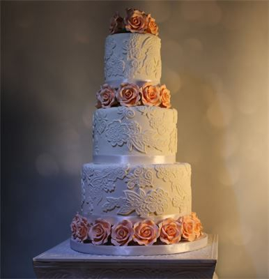 White Lace and Peach Roses Wedding Cake