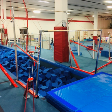 Uneven Bars Over Foam Pit at Inspire Sports Victoria in Saanich.  Recreational Gymnastics.  Competitive Gymnastics.