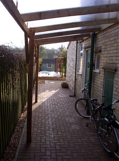 Wooden cycle shelter designed and installed by cambridge fencing and decking.