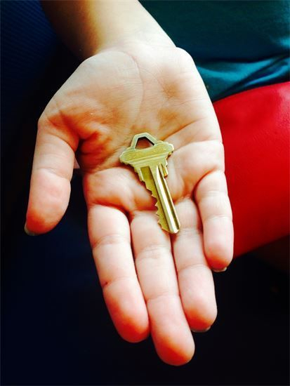 Image of person holding key