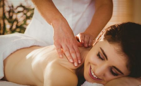 Woman getting massage from female therapist