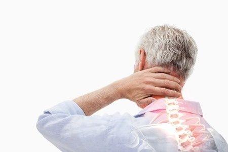 Stress man rubbing back of neck