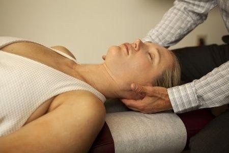 Chiropractor adjusting woman patient