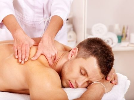 Man getting a massage from therapist