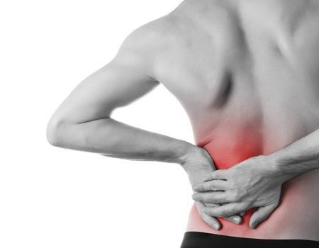 Man in pain holding lower back