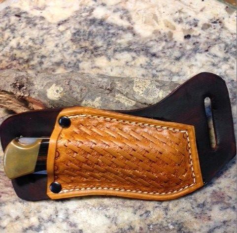 cross draw sheaths , buck 110 knives , basket weave tooling , leather sheath