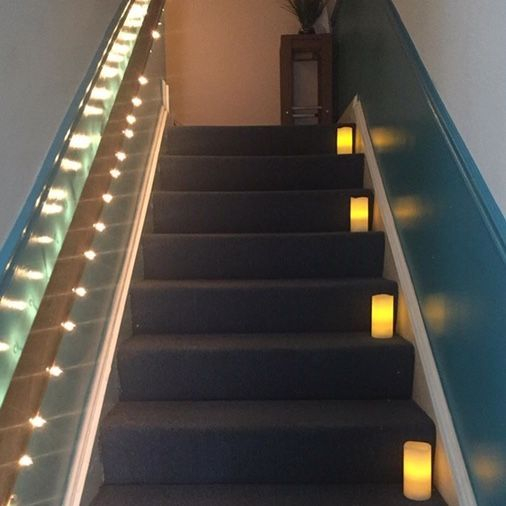 Relaxing candlelit stairwell in Alexandria, Virginia massage therapy studio