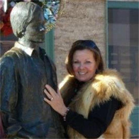 Phyllis standing on the corner in Winslow, AZ