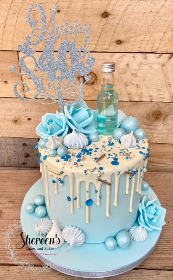 Topped with gin, blue roses and meringues
