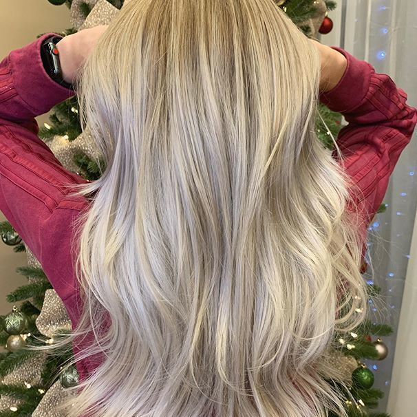 Long blonde hair with long layers.. Full foil babylights  toned to remove brassyness