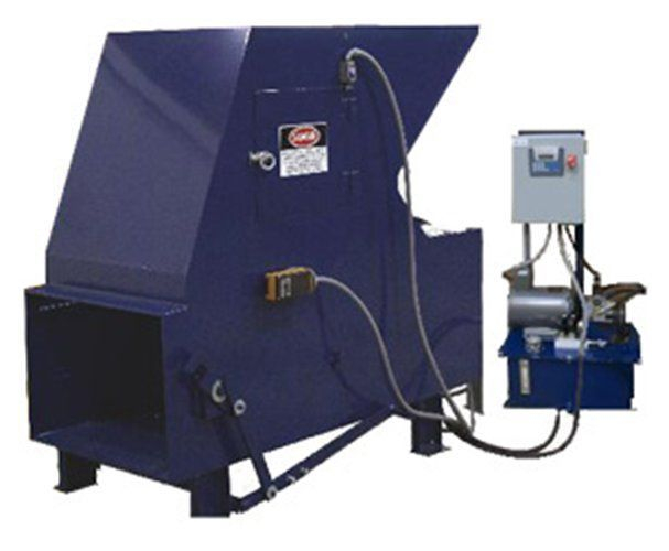 """CP1-C5 Container Compactor  The CP1-C5 computerized compactor is available in three heavy-duty models: Standard, Narrow, and Extra Heavy duty.  All models are reinforced in wear areas with 1/4"""" to 1/8"""" steel plate."""