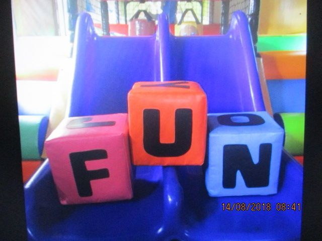 Three letter blocks on a violet slide