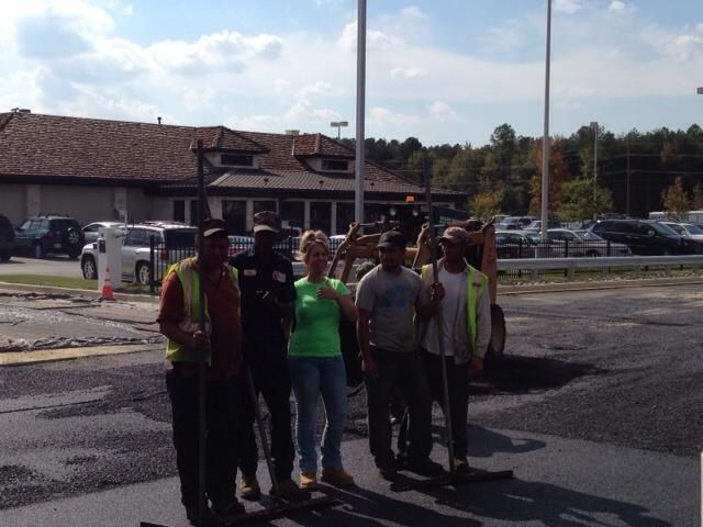 Paving crew poses for a picture on the job