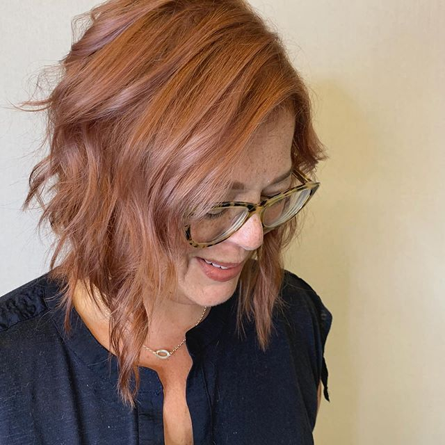 angled bob.. layered.. rose gold color.. styled with loose waves