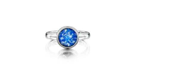 The Tribute Ring : Comes in 5 colours: Blue, Ruby, Green, Purple or Black Silver £295 Gold £375 White Gold £395 The Tribute Ring symbolises eternal love and togetherness. It holds a lifetime of special memories and tells a story that is completely personal to you. The Tribute Ring has an elegant, timeless design. Hand-cast in pure sterling silver, 9ct gold or white gold in one piece, there are no joins or seams so your ring is strong as well as beautiful. Your own personal message is diamond-point inscribed and touches your hand on the inside of the band.