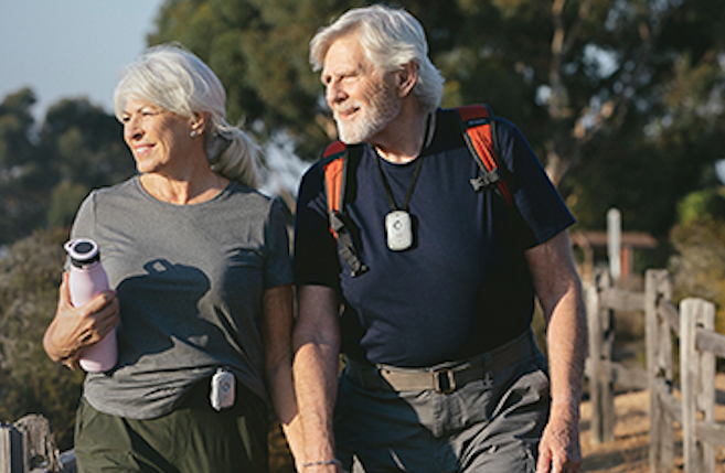 Senior man and women hiking with a GPS Safe Device