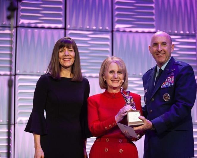 Rhoda Weiss receiving the Gold Anvil award with PRSA Chair Debra Peterson and Brigadier General Edwawrd Thomas, U.S. Air Force Director of Public Affairs