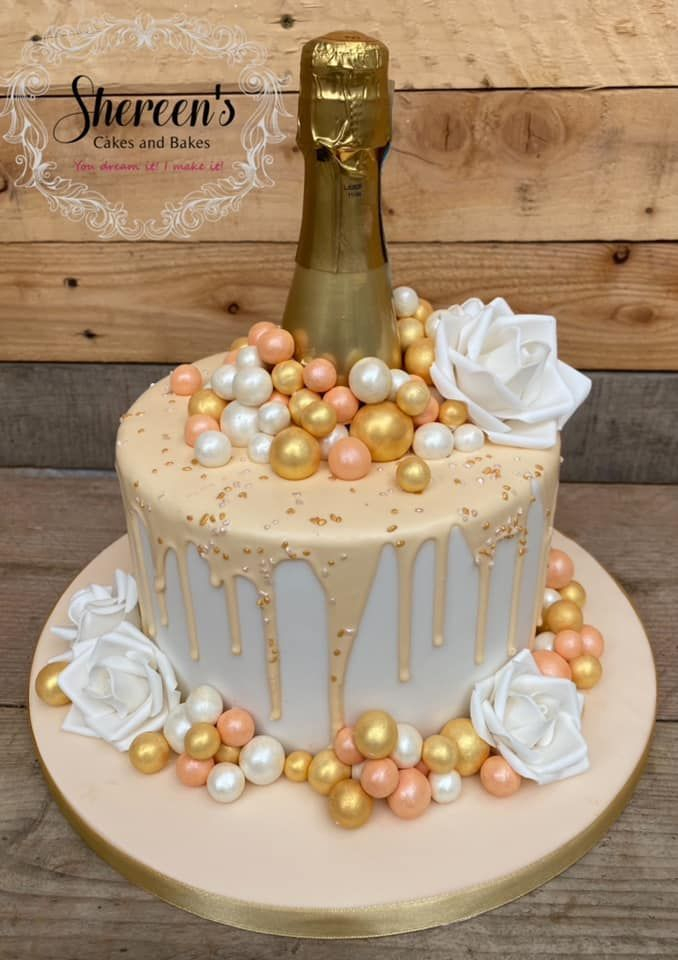 Topped with peach, gold and white 'bubbles'