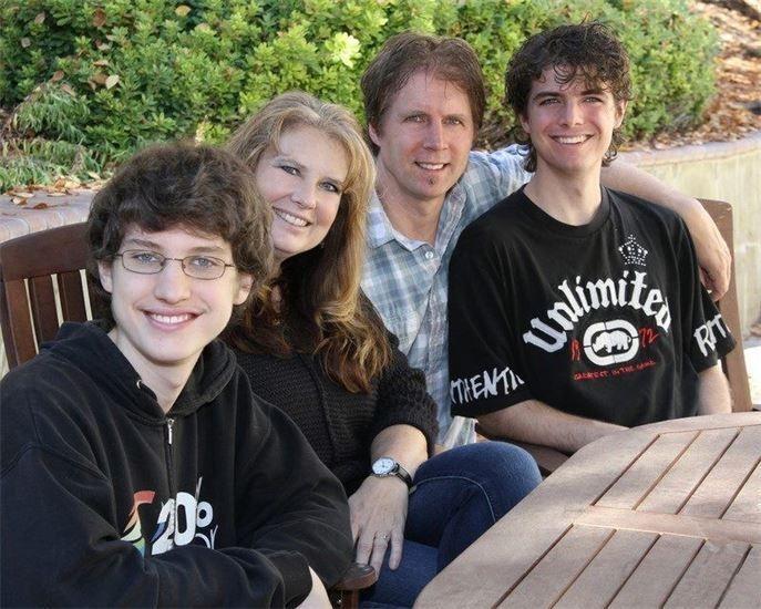 Family of 4 smiling, in order: Josh Biggs, Sonja Biggs CEO, Atom Biggs Board Member, Brandon Biggs CFO