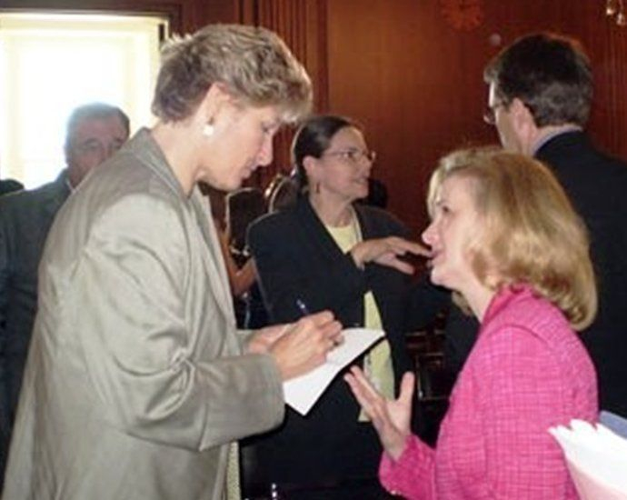 Rhoda talking with Karen Hughs, White House Chief of Staff of Communications