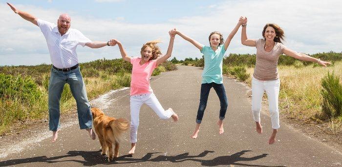Happy family jumping bare feet
