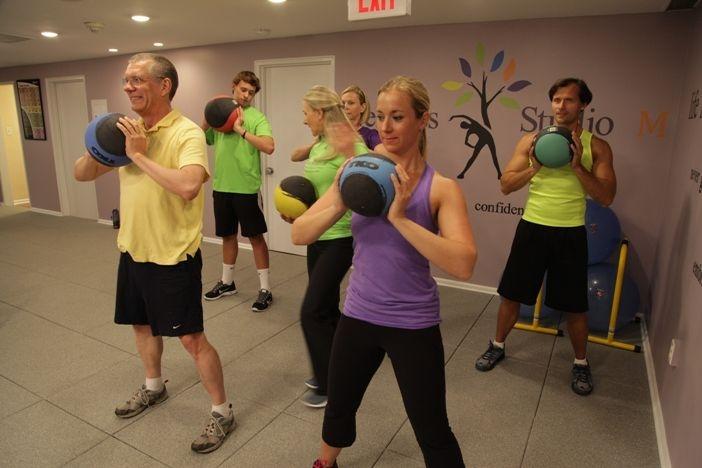 Group workout using medicine balls