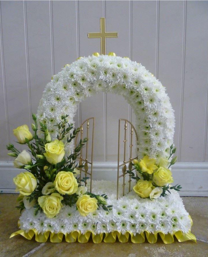 Gates of Heaven white flower funeral tribute