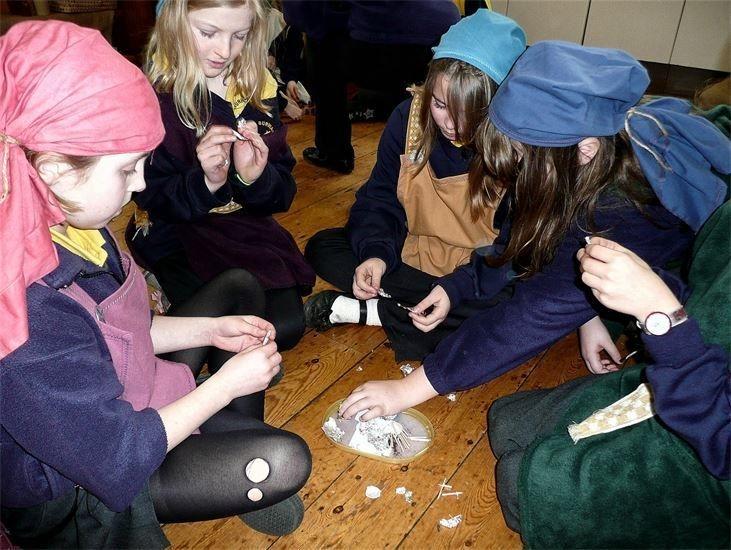 Viking women make amulets during their School Viking Workshop KS1 & 2