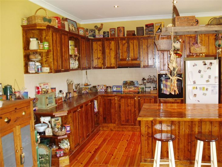 Country Look Kitchen Cabinets- Recycled Baltic Pine Benchtops and Cupboard Doors