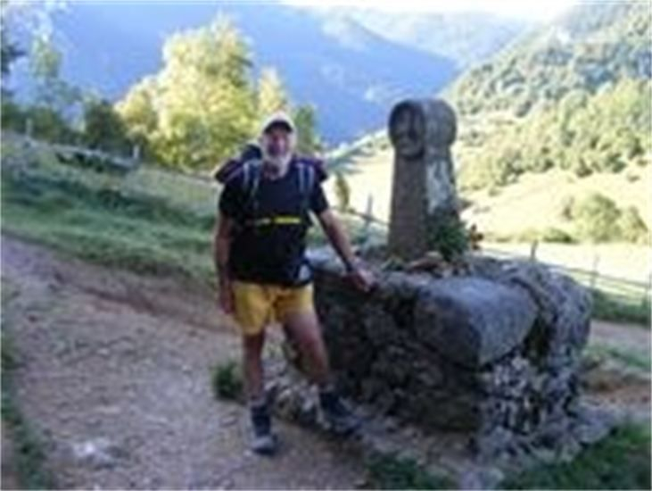 John at the mnjument below Monseqneur in southern France, where 208 Cathar perfects and supporters were burnt to death.