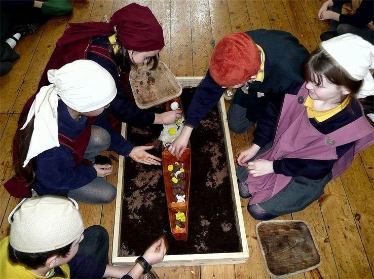 Viking boat burial during a primary school viking workshop