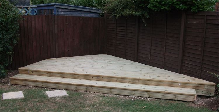 Wooden decking designed and installed by cambridge fencing and decking.