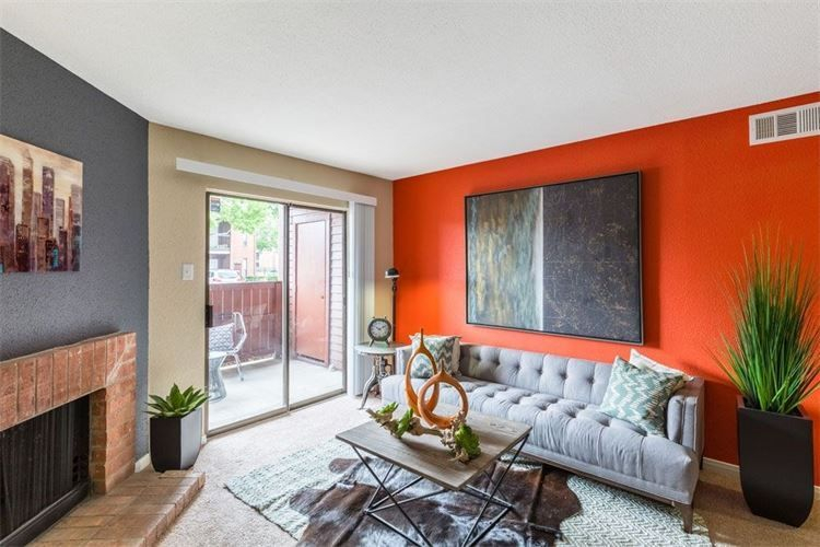 bright red and grey apartment living room with fireplace and patio