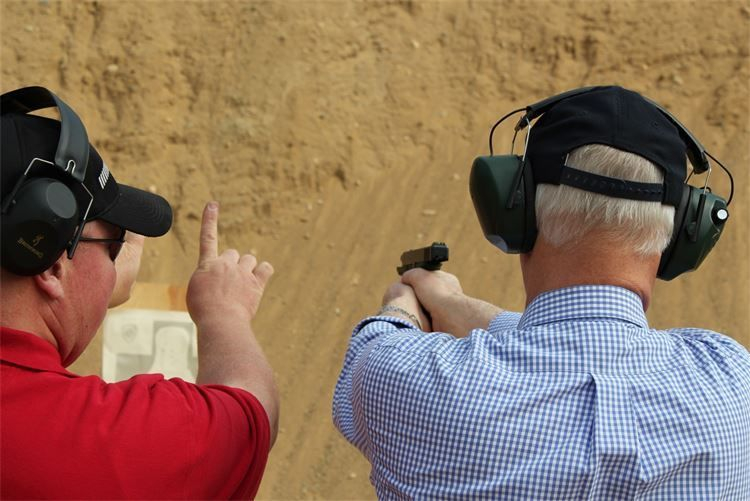 Andy providing a student with pointers on the fundamentals of shooting
