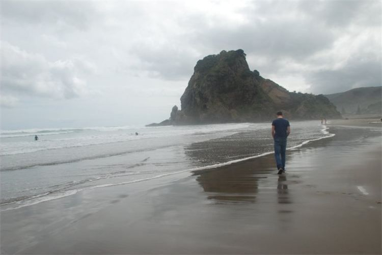 Solitary person on a beach, we can find happiness within, Reiki Energy Healing .