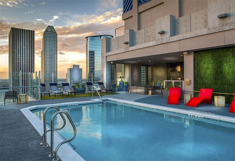 rooftop pool and terrace, downtown Houston city views, buildings