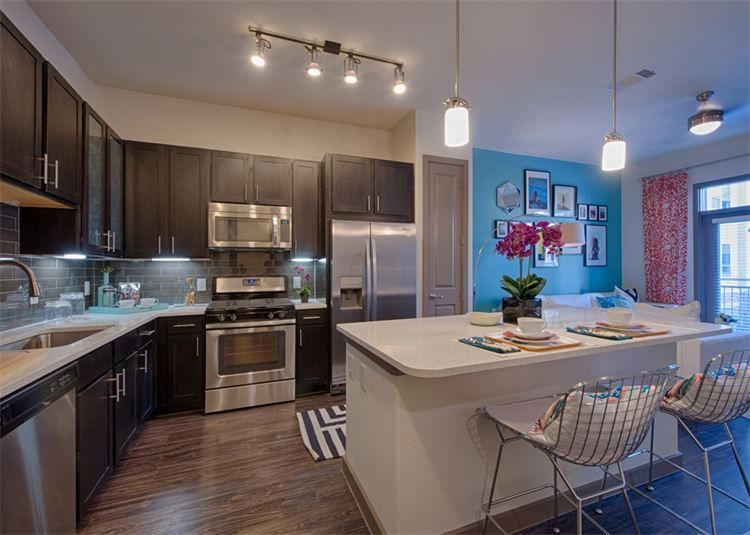 apartment gourmet kitchen with island and quartz countertops