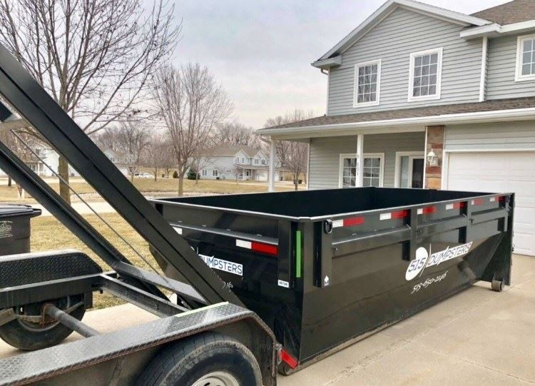 15 Yard Dumpster 4 feet sides with rear swinging doors which makes loading easy and convenient.