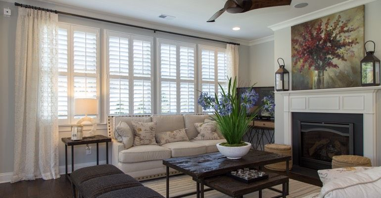 Photo of window drapes and blinds in living room