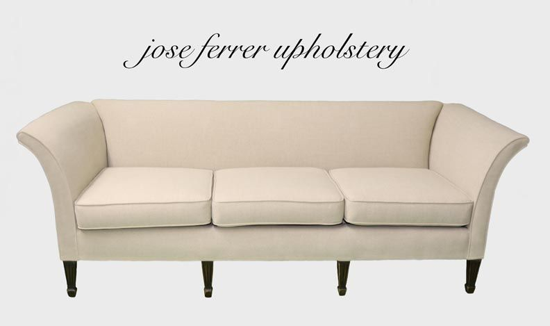 pullover sofa done in white linen fabric